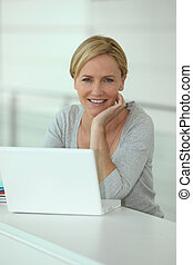 Blond woman in front of laptop computer