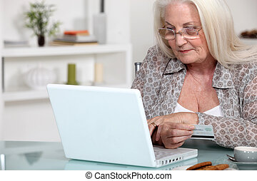 A mature lady doing online shopping