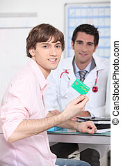 Young person showing his French health insurance card