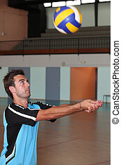 A man playing volleyball.