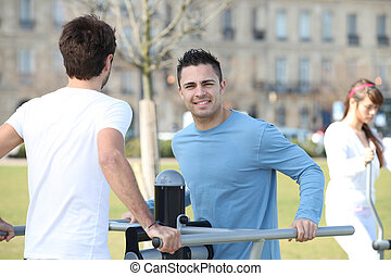 Man doing sports exercises outdoors