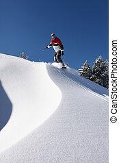 Man snowboarding downhill