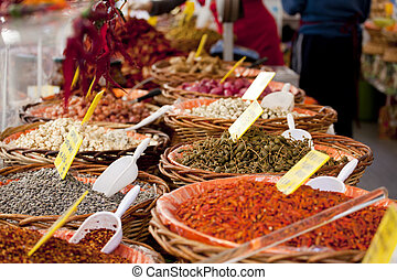 Spices on wooden basket in a street market