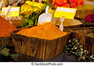 Turmeric on wooden basket in a street market