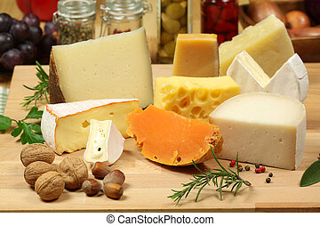 Cheese variety - Varieties of hard cheese on a wooden board...