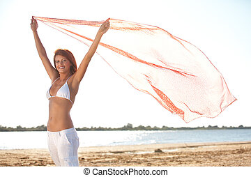 happy young woman holding scarf on beach - happy young woman...