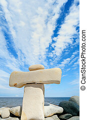 Haughty - Stack of two long pebble on the sea coast