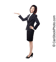 Full length Business woman introducing something by hand...