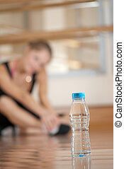 Resting athlete - Young girl is resting after fitness Bottle...
