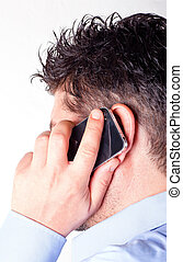 Man talking on the smart phone - white background