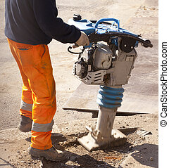 Worker with jackhammer in the street