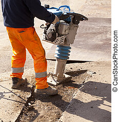 Worker with jackhammer in the steet