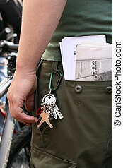 Keys attached to pants - Keys attached to green pants