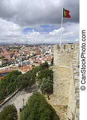 Portuguese flag waving in a tower of the castle of St....