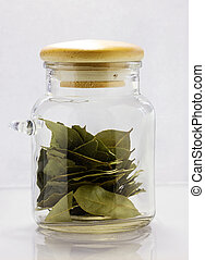 bay leaf - A glass jar with a bay leaf.