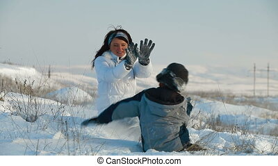 family fun in winter - mother and son have fun in the winter