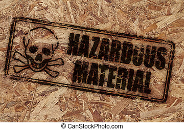 Hazardous material stamp on rough wooden background