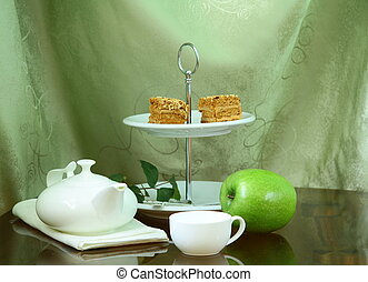 pretty cake stand with elegant china tea set