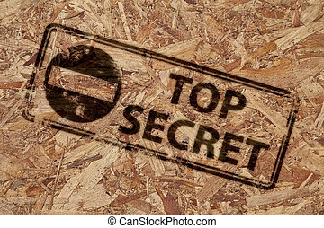 Top secret stamp on rough wooden background