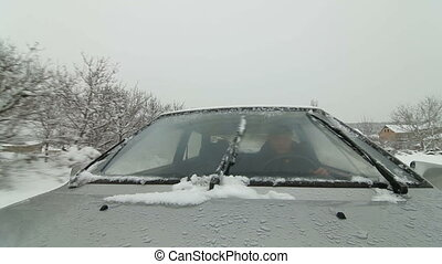 driving car in snowstorm