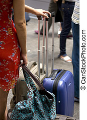 woman with luggage - Detail of a woman with luggage