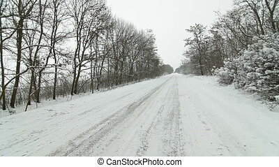 car on a country road in winter - car driving on a country...