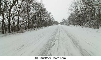 car driving on  snowy country road