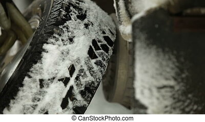 Changing winter tires -  winter  tires are mounted on a car
