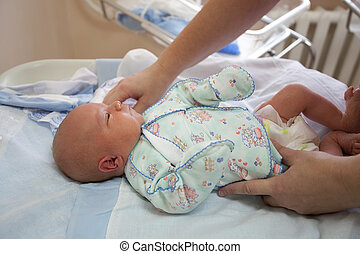 baby at the age of 4 days prepare in an extract from maternity hospital.