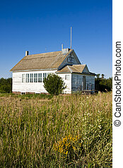 Old Schoolhouse - An old-fashioned vintage white one roomed...