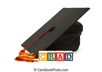Graduate - A grad hat with alphabet blocks are isolated on...