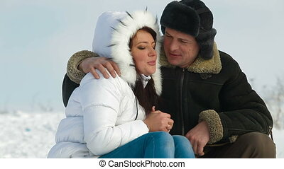 Couple Having Fun on a Sled - Adult Couple Having Fun on a...