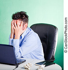 Frustrated businessman in his office - Frustrated and...