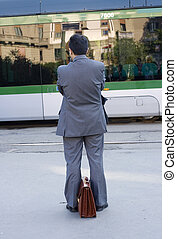 Businessman waiting for the tram