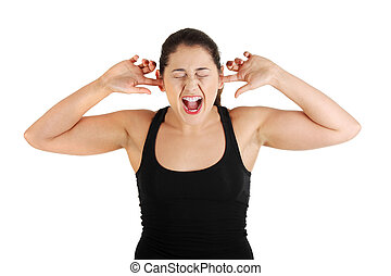 Teen plugging her ears and shouting - Front view portrait of...