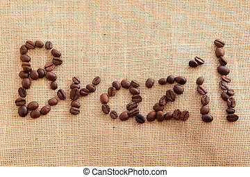 Coffee beans on linen background Brazil Text symbol