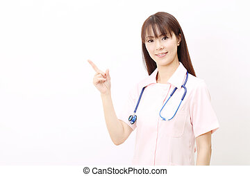 Young asian female nurse pointing