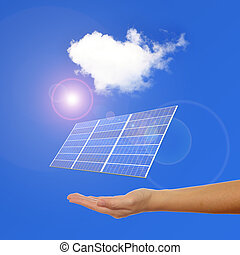 hand with Solar Panel , sunlight and blue sky background