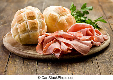 Mortadella with Bread on Chopping board - Sliced soft...