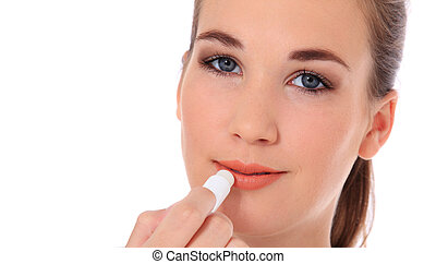 Woman using lip balm - Attractive young woman using lip balm...