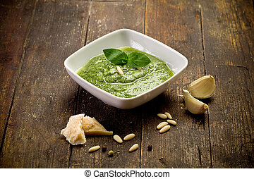 Pesto - fresh pesto sauce inside a bowl on wooden table