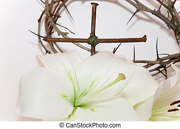 Crown of Thorns, crucifix and Easter white Lily on white...