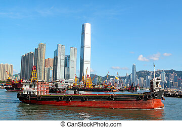 Construction barges in in Victoria Harbor, Hong Kong