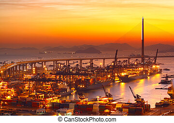 Port warehouse with cargoes and containers at sunset