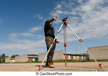 Land surveyor on construction site - Land surveyor working...