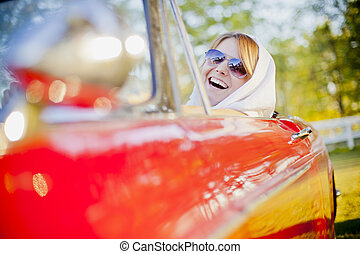 Young girl in cabriolet