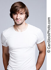 young man - young handsome man in white t-shirt, studio shot