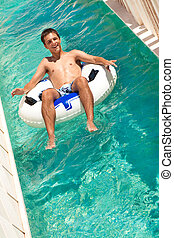 summer fun in aquapark - teen boy having fun in waterpark
