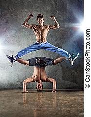 Two men dancing - Two young strong men dancing.