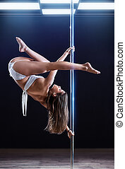 Young pole dance woman - Young strong pole dance woman